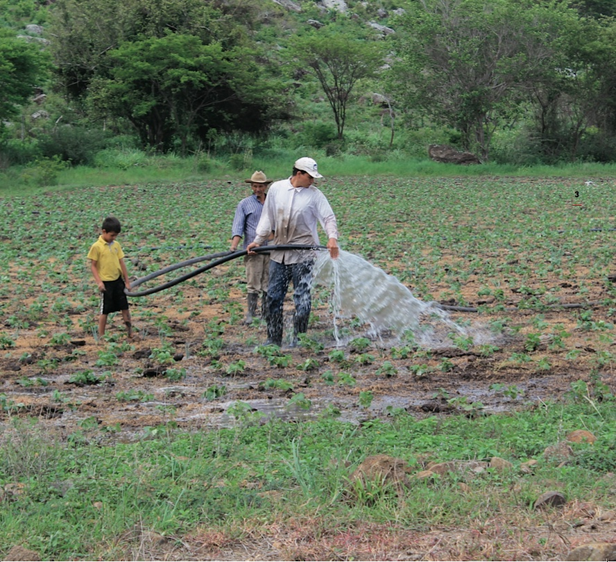 int water management family watering crops 2 - climate adaptation.