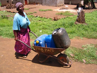 Woman transporting water in Ga-Selala village, Sekhukhune (Photo: Gina Ziervogel)