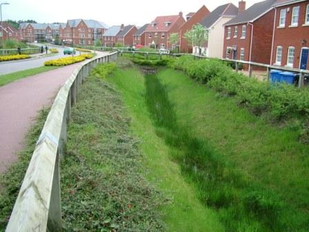 Sustainable drainage in a new housing development weadapt for Design of maturation pond