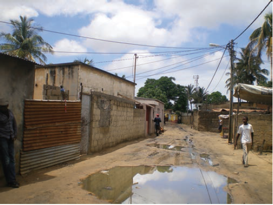Chamanculo C is an older unplanned neighbourhood outside the 'Cement city' of Maputo. Lack of drainage causes unpaved streets to flood.