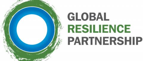 Logo of the Global Resilience Partnership: layers of circles, with a white round in the middle, then a thick blue circle, then a vrey thing white circle, then a green circle