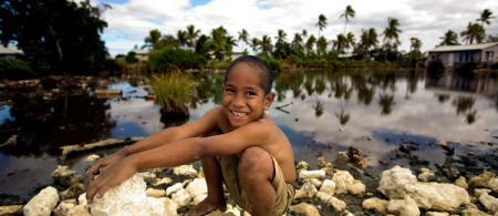 Boy playing near a flooded area in Popua Village at the outskirts of Nuku'alofa, the Capital of Tonga. Photo credit: Asian Development Bank, via Flickr