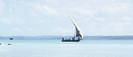 Fishermen on traditional dhow sailboat off the coast of Pemba, Tanzania