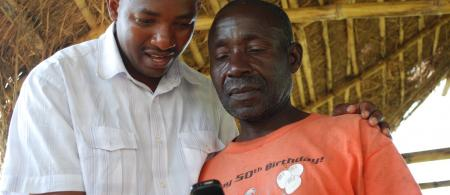 A farmer in Kenya using the P2P service WeFarm. Credit: Camilla Gordon and Kenny Ewan.