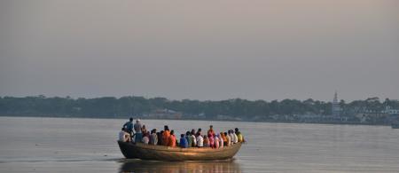 People crossing a river in Bangladesh - Credit: Sonja Ayeb-Karlsson