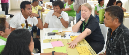 Community members discuss actions to address the growing waste problem in their area