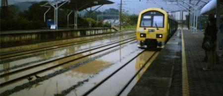 4eb7efefa947ccommuter-train-flooded-tracks - climate adaptation.