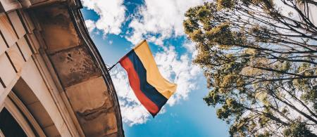 Colombian flag with the blue sky on background.