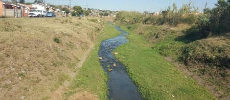 Stream flowing in a residential area