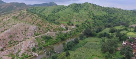 Degraded land, with parts restored by villagers working with the Watershed Organisation Trust