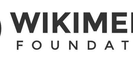 The Wikimedia Foundation logo is a stylised circle with a smaller circle within it, with the outline of a person with their arms reaching upwards in the centre. On the right, Wikimedia Foundation is written in large letters.