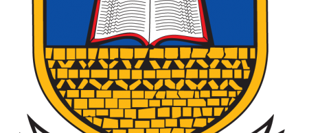 Logo is a shield with and animal sitting on a book on top of a red star and a brick wall.