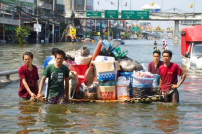 Residents moving their belongings on a raft during the 2011 Thailand floods