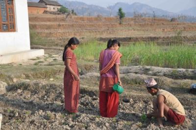 505074e37b203nepal-farmer-family 1 - climate adaptation.