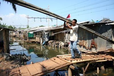 man carrying bamboo, Jakarta