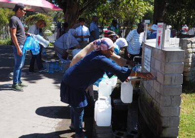 Residents of Cape Town queue for water during the drought. Photo: fivepointsix / Getty Images.