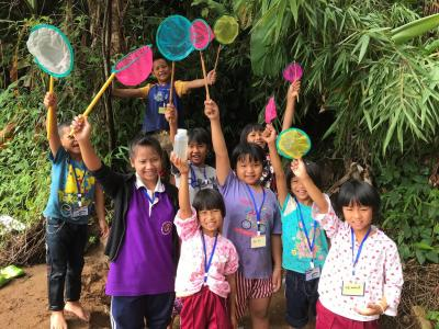 Girls and boys take part in a climate change adaptation project activity in Thailand