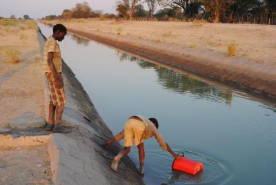 Child fetching water from canal in rural Namibia (Photo by Irene Kunamwene, ASSAR)