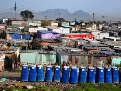 Residents of Khayelitsha township in Cape Town face numerous everyday, chronic risks which must be addressed in order to build resilience. Photo: Photo: Masixole Feni via GroundUp.