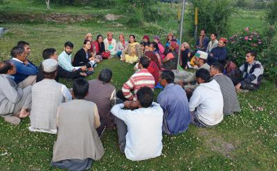 People gathered and discussed, sitting on green grass