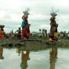 women by river