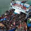 Haitian citizens crowding on a ship